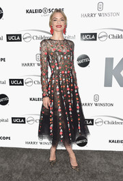Jaime King complemented her dress with a pair of black lace pumps by Jimmy Choo.