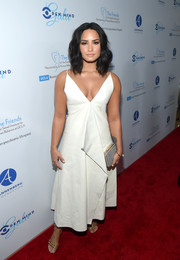 Demi Lovato polished off her look with a metallic silver clutch by L.K.Bennett.