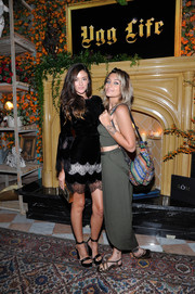 Paris Jackson teamed flat sandals with moss-green separates for the UGG x Jeremy Scott launch.