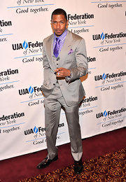 Nick Cannon opted for a super snazzy three-piece suit which he paired over a gingham purple button down and a matching tie.