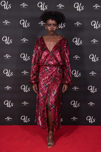 Lupita Nyong'o looked festive in a sequined plaid wrap dress by Attico at the UK exclusive screening of 'Us.'