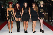 Jesy Nelson went for a classic and elegant look with a sheer sleeve deep-V LBD.