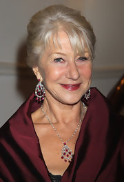 At the UK premiere of 'The Debt', Helen Mirren wore an elegant diamond and ruby pendant set in 18-carat white gold on a diamond-beaded chain along with a pair of diamond and ruby drop earrings set in 18-carat white gold.