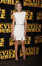 Rosamund Pike was white hot at the UK premiere of The Devils Double wearing an Alexander McQueen boucle cocktail dress. The strong shoulders and thigh slits were classic McQueen, adding a twist with a zippered waistline. The blonde beauty opted for a messy updo and simple black peep-toe pumps.