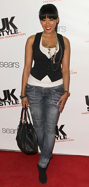 Kim wore worn in jeans with a tank and vest for the UK Style Launch.