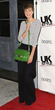 Agyness Deyn gave her monochromatic attire a bold pop of color with a vibrant green Proenza Schouler PS11 bag.