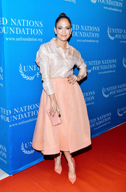 Jennifer Lopez paired her shirt with an ultra-girly pale-peach skirt, also by Christian Siriano.
