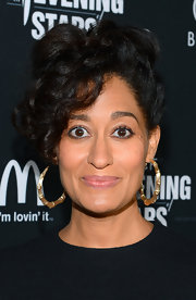 Tracee Ellis Ross wore a pair of costume bamboo-inspired hoop earrings.