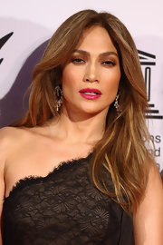 Jennifer Lopez brought her signature glamour to the charity gala with her lightened air-blown tresses.