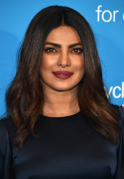 Priyanka Chopra framed her gorgeous face with this center-parted wavy hairstyle for the UNICEF 70th anniversary event.