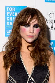 Suki Waterhouse wore her hair loose with mussed-up waves during the UNICEF Halloween Ball.