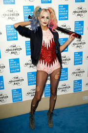 Poppy Delevingne completed her costume with a pair of tattered fishnet tights.