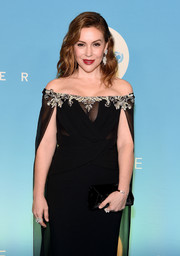 Alyssa Milano paired a black velvet envelope clutch by Tyler Ellis with a matching off-the-shoulder dress for the 2018 UNICEF Snowflake Ball.