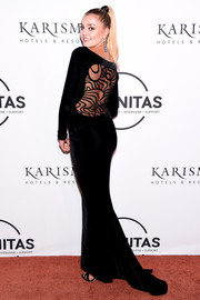 Rachel Hilbert glammed it up in a black velvet fishtail gown with a peekaboo back at the UNITAS Gala Against Human Trafficking.
