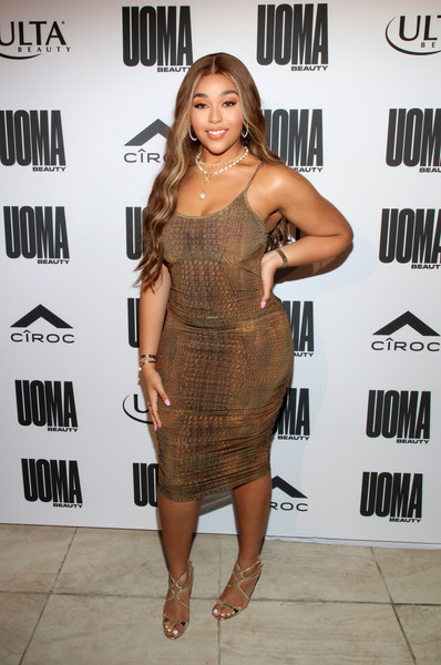 Jordyn Woods teamed her sexy frock with strappy gold heels by Jimmy Choo.