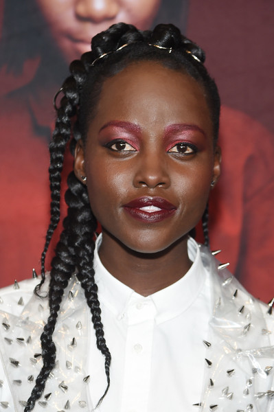 Lupita Nyong'o wore her hair in multiple braids at the New York premiere of 'Us.'