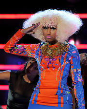 Nicki added a bold touch to her printed dress with a bronzed beaded necklace.