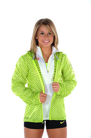 A neon-green windbreaker brightened up Shawn Johnson's look during the USOC portrait shoot.