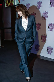 Sophie Marceau makes her fashion mark in this shimmering navy pantsuit.