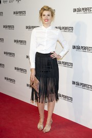 Adriana Abenia spiced up her simple top with a fringed black skirt.