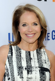 Katie Couric wore her hair down to her shoulders with flippy ends during the LA premiere of 'Under the Gun.'