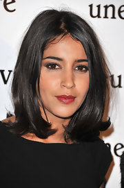 Leila Bekhti wore a soft brick red lipstick layered with gloss at the Paris premiere of 'Une Vie Meilleure.'