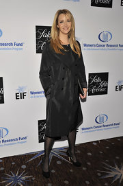 Lisa Kudrow went for a dark look with a black trenchcoat, tights, and pumps at the Unforgettable Evening Benefit.