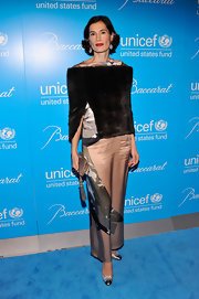 Annette Lauer knows the details make the difference. She chose an old rose tasseled clutch that went perfectly with her silk outfit at the Unicef SnowFlake Ball.