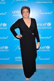 Caryl looked simply eelgant in this draped black wrap-gown at the UNICEF Snowflake Ball.