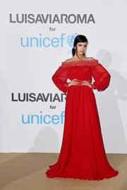 Sofia Carson went for boho glamour in a red off-the-shoulder gown by Giambattista Valli at the UNICEF Summer Gala.