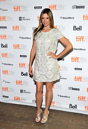 Mira Sorvino paired silver strappy sandals with her beaded dress for a lovely finish.