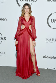 Barbara Fialho flashed some abs and leg in a red cutout gown by Rapha Mendonca at the Unitas Gala Against Human Trafficking.