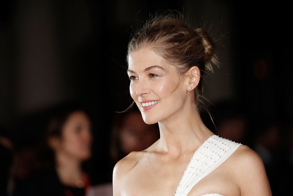 Rosamund Pike sported a slightly messy bun during the BFI London Film Festival opening night gala.