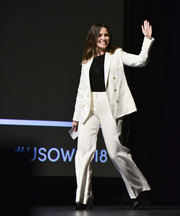 Sophia Bush teamed a white pantsuit with a black shirt for the 2018 United State of Women Summit.
