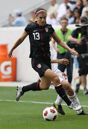 Alex Morgan wears the Team USA black soccer jersey during this match against Mexico.
