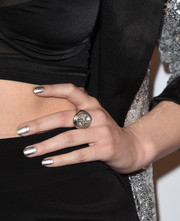 Hailee Steinfeld added more shine with a silver mani.