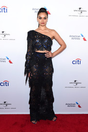 Shanina Shaik was boho-glam in a fringed, one-sleeve crop-top by Raisa & Vanessa at the Universal Music Group Grammy after-party.