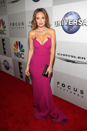 Catt Sadler looked absolutely gorgeous at the Universal Golden Globes after-party in a strapless fuchsia gown with an angular sweetheart neckline.