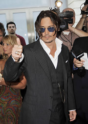 Johnny Depp flashes two gold rings, one plain and one with a diamond.