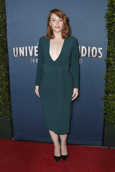 Bryce Dallas Howard looked va-va-voom in a plunging, figure-hugging green dress by Bec + Bridge at the Jurassic World: The Ride grand opening.