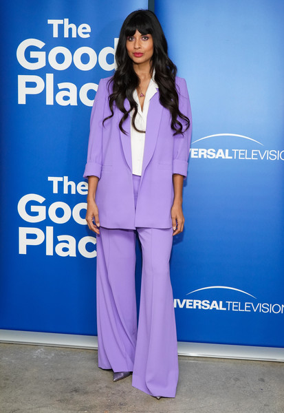 Jameela Jamil suited up in this lavender blazer and wide-leg pants combo by Alice + Olivia for the 'Good Place' FYC event.