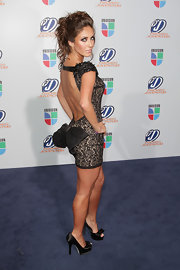 The bows on Anahi's black satin pumps were a perfect match for her dress' unique backside.