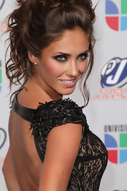 Anahi kept the focus on her dramatic smoky eyes, finishing off her beautiful look with pale pink lips.