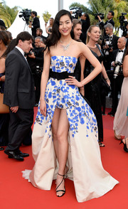 Liu Wen flashed plenty of leg in a Giambattista Valli floral strapless gown with a high-low hem during the Cannes premiere of 'The Unknown Girl.'