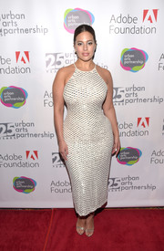 Ashley Graham complemented her dress with elegant silver sandals by Jimmy Choo.