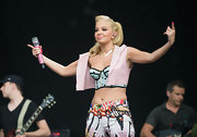 Tulisa layered a pretty pale-pink vest over her polka-dot corset top to balance out the look.