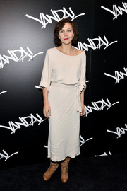 Maggie Gyllenhaal went for relaxed sophistication in a belted off-white midi dress at the grand opening of Vandal.