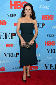 Julia Louis-Dreyfus polished off her red carpet look with a black and gold beaded clutch.