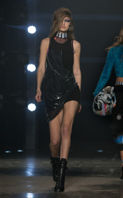 Gigi Hadid was edgy-sexy in an asymmetrical, draped LBD on the Versus runway.