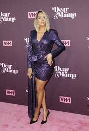 La La Anthony donned a metallic purple mini dress by Redemption for the 'Dear Mama: A Love Letter to Moms' screening.